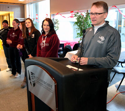 ACCCougars coach Terry Arksey introduces his team during an announcement that the Cougars will host the Senior A and B provincial playoffs in Brandon in March.