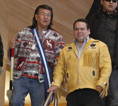 Raymond Robinson (left) and Chief Garrison Settee (right) arrive at  the James A. Richardson International Airport Friday, after Robinson ended a six-week fast  with Attawapiskat Chief Theresa Spence.
