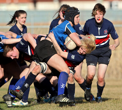 Minnedosa's Hailey Rapsky tries to stop Kendra Roberts of Souris in high school action. Both play for Team Manitoba.