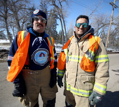 Brandon Fire & Emergency Services firefighter paramedics Matthew Tannas and Adrian Fraijo stand outside Firehall No. 2 in Brandon on Thursday. Any program that helps firefighters with job related stress would be helpful, they said. The two shared their insights during a break from their rooftop campout fundraiser for charity on Thursday. (Melissa Verge/The Brandon Sun)