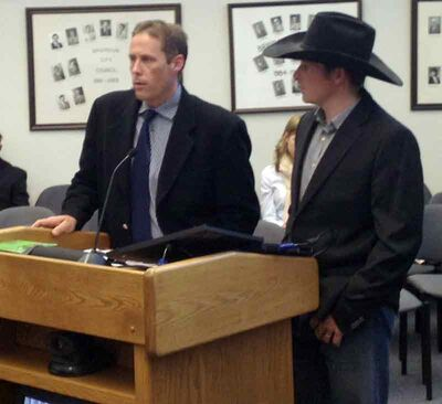 Chad Stiles (left) and Alistair Hagan of the Manitoba Rodeo Cowboys Association speak to council Monday regarding their accommodation tax funding request for the Wheat City Stampede.