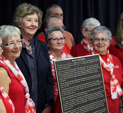Manitoba Lt.-Gov. Janice Filmon poses with members of the Rivers Train Station Restoration Committee, including Betty Macdonald, centre, and Marlene Hayhurst, right, on Friday in Rivers, beside a newly unveiled plaque to commemorate the 100th anniversary of the Rivers train station.