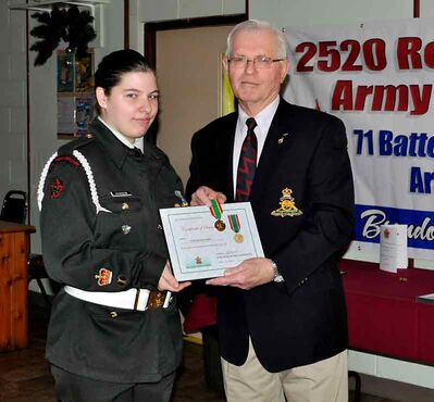 During the Christmas Dinner, Warrant Officer Heather Windsor was promoted to Master Warrant Officer and received the Army Cadet Long Service Medal for the completion of four successful years with Royal Canadian Army Cadets. Making the presentation was Col. Don Berry representing the Army Cadet League of Manitoba.