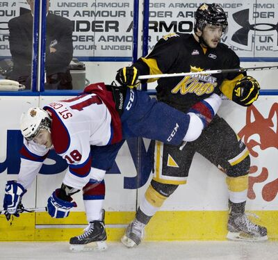 Darian Dziurzynski collides with Edmonton Oil Kings forward Michael St. Croix during an April 7 playoff game in Edmonton.