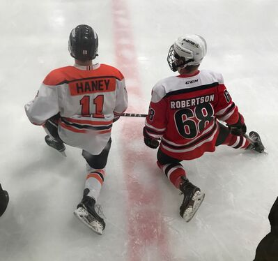 Brandonite Dylan Haney of the University of Jamestown Jimmies chats with his friend, Carberry product Jordan Robertson of the Minot State University Beavers, at centre ice prior to a game last season.