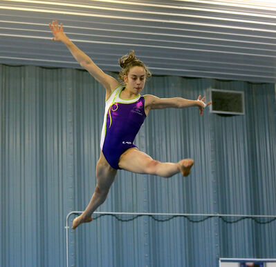 Isabela Onyshko leaps high above the four-inch wide balance beam Friday at the Brandon Eagles Centre.
