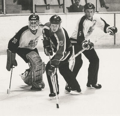 Gord Paddock, in white, is shown with goaltender Ron Hextall in Western Hockey League action with the Brandon Wheat Kings during the 1983-84 season.