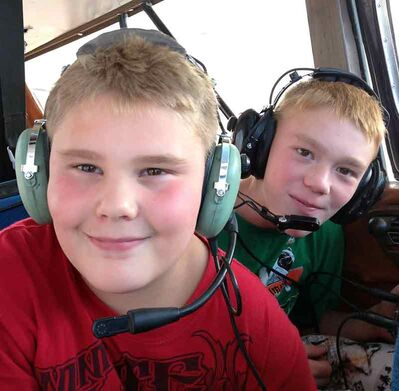 Waskada is mourning the deaths of local pilot Darren Spence, the man's two sons — Logan, foreground, and Gage, background — and another boy, Dawson Pentecost, who was a family friend. They were killed in a plane crash Sunday near the community.