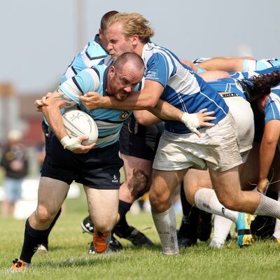 Shawn Sarkonak of the Brandon Barbarians is tackled by Luke Zinger of the Winnipeg Assassins during Division 1 Manitoba Senior Rugby action at John Reilly Field on Saturday afternoon.