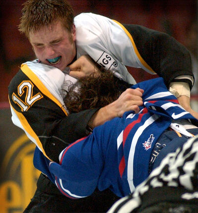 Brandon Wheat Kings forward Tyler Dyck fights Regina Pats forward Rick Rypien during Game 2 of their Western Hockey League playoff series at the Keystone Centre on March 22, 2003. (Brandon Sun file photo)