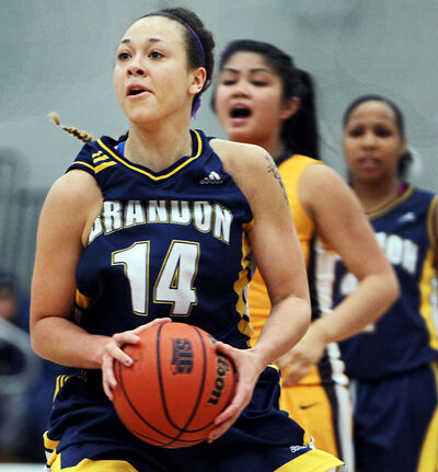 Brandon University Bobcats import guard Cassie Cooke drives to the basket in Canada West conference women's basketball action against the Manitoba Bisons on Saturday night.