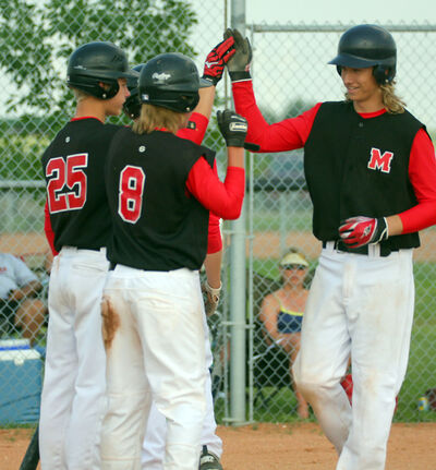 """Midwest's Chad Kilimnik celebrates his three-run home run against the North Winnipeg Pirates with a pair of teammates in last year's UCT Canada Day Classic Bantam AAA final. Kilimnik is part of what coach Derek Shamray calls a """"good core group"""" heading into this week's 18-and-under national championship."""
