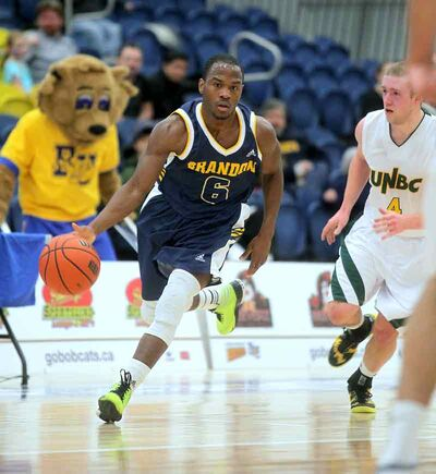Ilarion Bonhomme moves the ball up the court during the Brandon Bobcats' game against the UNBC Timberwolves at the BU Healthy Living Centre on Sunday.