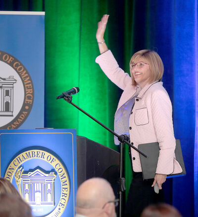 Mayor Shari Decter Hirst waves during her State of the City address to the Brandon Chamber of Commerce at the Victoria Inn's Imperial Ballroom on Thursday.