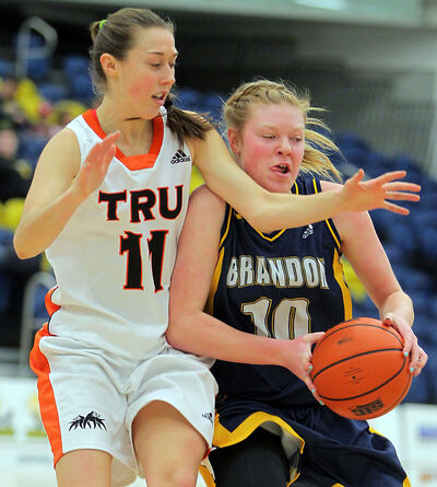 Brandon University Bobcats rookie Kinsley Ransom fends off Thompson Rivers WolfPack's Taiysa Worsfold in Canada West women's basketball action on Friday night at BU.