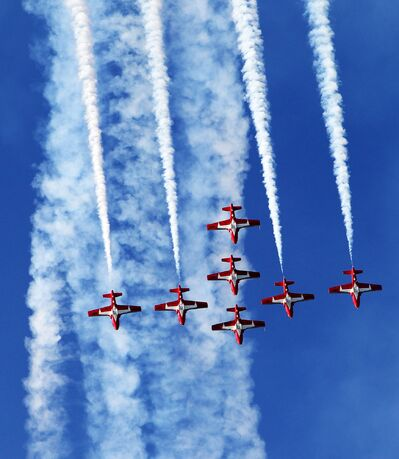 The Canadian Forces Snowbirds perform a manoeuvre during their aerial demonstration at the 25th anniversary Shoal Lake Airshow at the Shoal Lake Regional Airport on Wednesday evening.