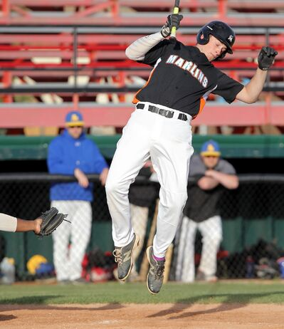 Jordan Foote of the Brandon A&W Marlins leaps to avoid a wild pitch during Manitoba Junior Baseball League action against the St. Boniface Legionnaires at Andrews Field on Wednesday evening.
