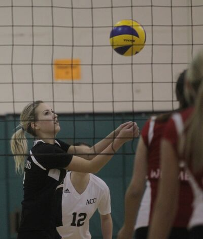 The ACC Cougars' Stephanie Willey keeps the ball in play against the visiting Wesmen during Sunday's collegiate volleyball game at Assiniboine Community College.