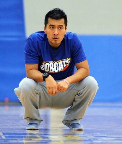 BU coach Gil Cheung watches intently during yesterday's practice.