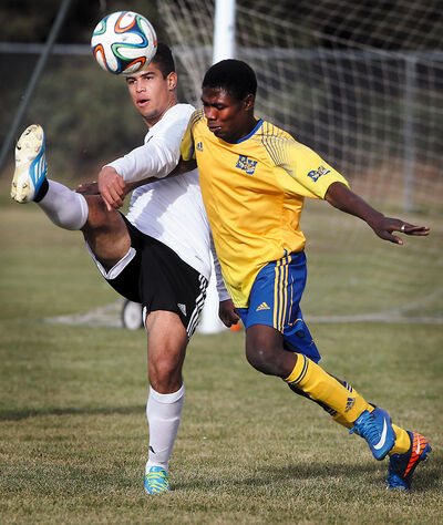 Brandon University's Basiru Wasiu Ademola (right) battles Red River's Diego Santos during men's soccer action on Sunday afternoon at the Vincent Massey High School field.