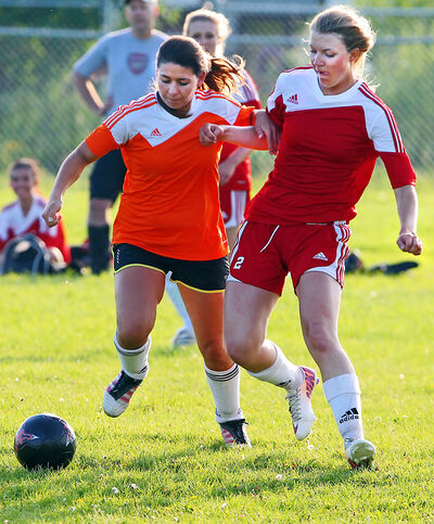 Kate Osadchuk (right) of Chaos and Melissa Zorzos of Crush battle for the ball Thursday.