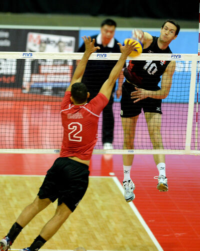 Toon Van Lankvelt of Rivers hammers a kill for Team Canada.