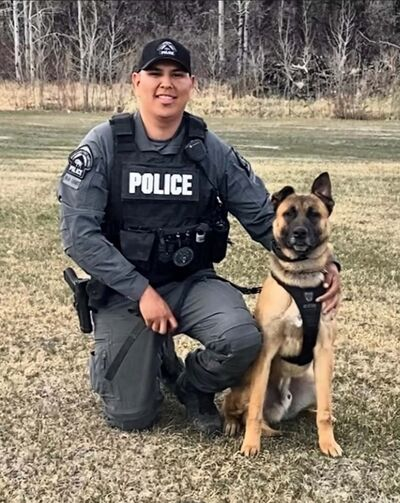 Const. Travis Assiniboine and police K-9 Zion. (Submitted)</p></p>