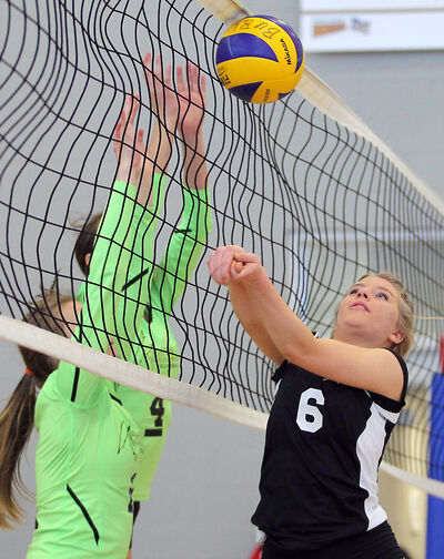 Cats Gold team member Arista Kreshewski plays the ball during the Cats Club 15U volleyball tournament third-place match against Kryptonite on Sunday.
