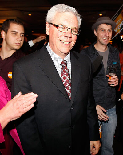 NDP Leader Greg Selinger enters party headquarters in Winnipeg after winning the provincial election with the NDP's fourth straight majority government on Tuesday.