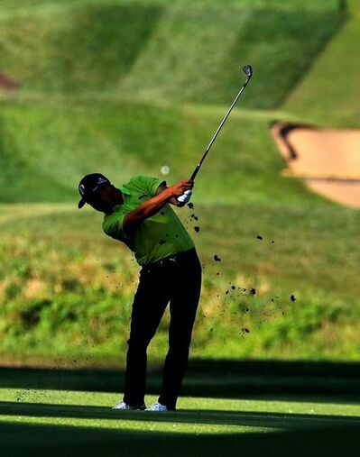 Rickie Fowler hits from the 12th fairway during the first round of the PGA Championship golf tournament at Bellerive Country Club, Thursday, Aug. 9, 2018, in St. Louis. (AP Photo/Charlie Riedel)