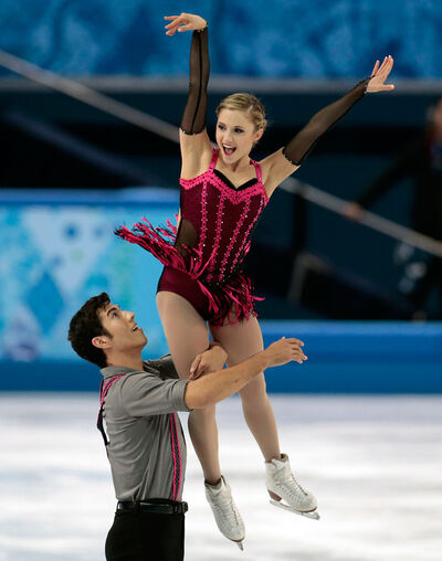 Rudi Swiegers lifts pairs partner Paige Lawrence during their short program at the Winter Olympics last month in Sochi, Russia. The skaters are now preparing for the world championships which take place in Saitama, Japan from March 24-30.
