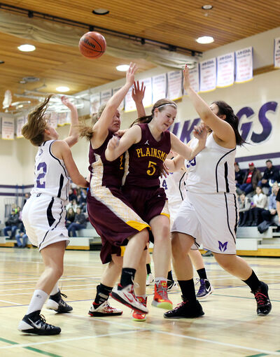 Frances Krinke and Emilie Smale (No.5) of the Crocus Plainsmen get tangled up as they battle under the hoop during the varsity girls' basketball city semifinal Thursday at Massey.