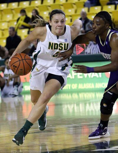 Guard Danielle DeGagne of Brandon drives to the basket in a recent game for the North Dakota State University Bison.