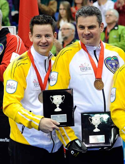 Skip Rob Fowler (left) with his right-hand man, third Allan Lyburn, after earning bronze medals at the Brier.