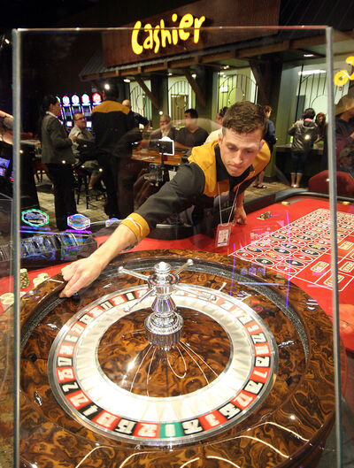 A dealer spins the roulette wheel at the new Sand Hills Casino on Monday.