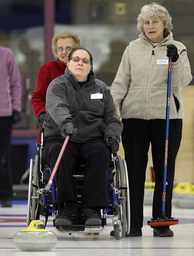 Heather Mowat delivers a stone during senior women's curling action  at the Brandon Curling Club on Thursday.