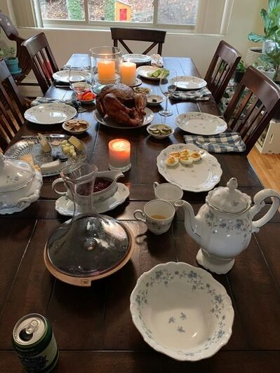 This Nov. 28, 2019 photo provided by Tracee Herbaugh taken on Thanksgiving near Boston, Mass., shows Herbaugh's Johann Haviland Blue Garland china. The china belonged to Herbaugh's grandmother. (Tracee Herbaugh via AP)