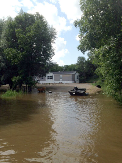 Water from the Qu'Appelle River in St. Lazare continues to rise, threatening several homes and buildings including Owen Jessop's home which was built just last year to replace his old home destroyed by the 2011 flood.