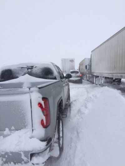 Vehicles were stranded on the highway from Monday evening into Tuesday, long enough for snow drifts to start building between cars and under semi trucks.