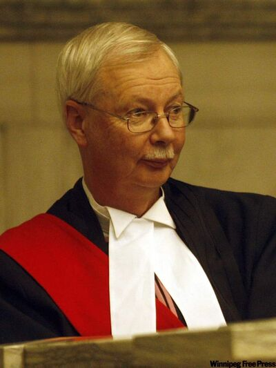 "A Nov. 2009 file photo of Manitoba Judge Robert Dewar, who recently spared a convicted rapist jail time because the victim sent signals that ""sex was in the air"" through her suggestive attire and promiscuous conduct."
