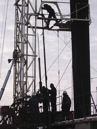 Men drill a well in the Waskada area — which can be a dangerous job.