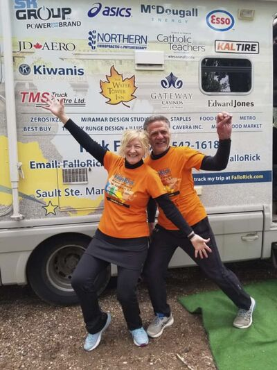 Colette and Rick Fall pose for a photo in late May next to their recreational vehicle. Since April 12, Rick has been running across the country to raise money for charity, while Colette has followed alongside him in the RV. On Tuesday, the pair finally arrived in the Brandon area. (Submitted)</p></p>