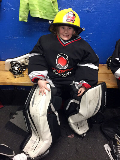 Sometimes while playing hockey, Olivia Brown gets to strap on the pads herself. Seen here after a recent novice game where her superb play in net was worthy of player of the game honours.