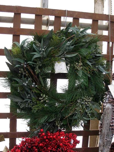 Adding some broadleaf evergreen stems to a wreath adds interest and texture. Photo taken at The Green Spot.