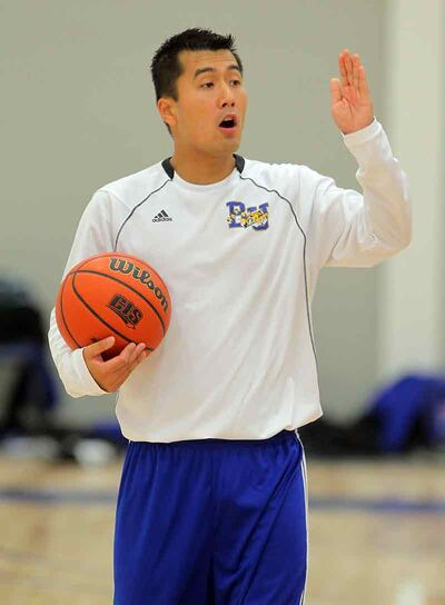 Head coach Gil Cheung puts the Brandon University Bobcats men's basketball team through its paces Thursday afternoon at the Healthy Living Centre.