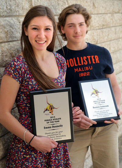 Emma Donnelly and Keaton Jameson pose with their Crocus Plains athlete of the year awards on Thursday.