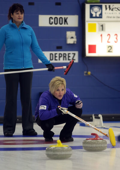 Brandon's Lois Fowler calls a shot from the house as Judy Colwell looks on during the provincial senior women's curling championship on Thursday at the Brandon Curling Club.