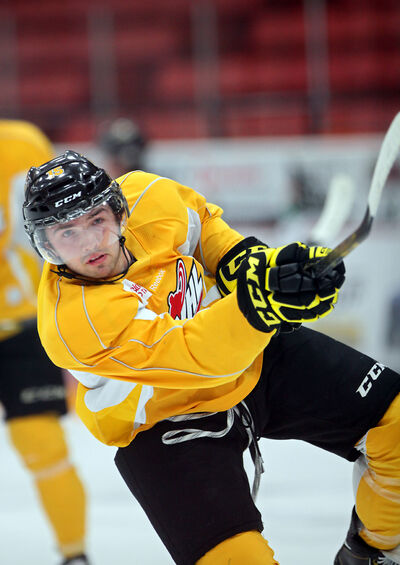Wheat Kings forward Peter Quenneville takes a shot in practice Wednesday.