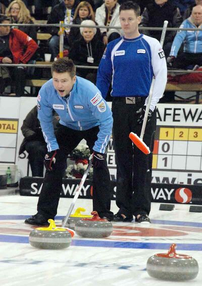 Mike McEwen calls on his sweepers while Brandon's Rob Fowler watches in Friday night's first playoff game.