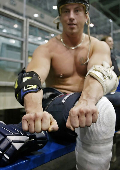 John Hewitt is seen showing the difference in the size of his hands suffered from years of fighting in 2005. Hewitt, who was a fighter in the Battle of the Hockey Enforcers in 2005, was arrested on Tuesday after a standoff with police.